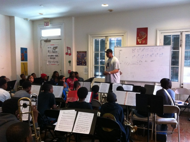 Derrick Tabb teaching students at The Roots of Music