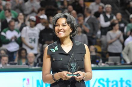 Dr. Krystal Banfield accepts the Heros Among Us Award