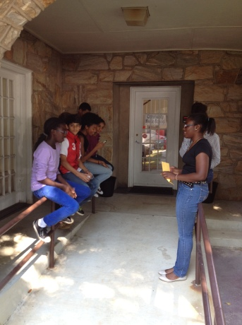 Students singing songs to each other on a break during the Composition Workshop